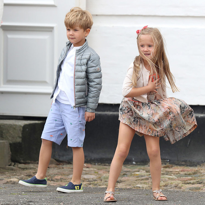 Double the fun! Josephine twirled her summer dress as her brother Vincent struck a pose in Grasten, Denmark.