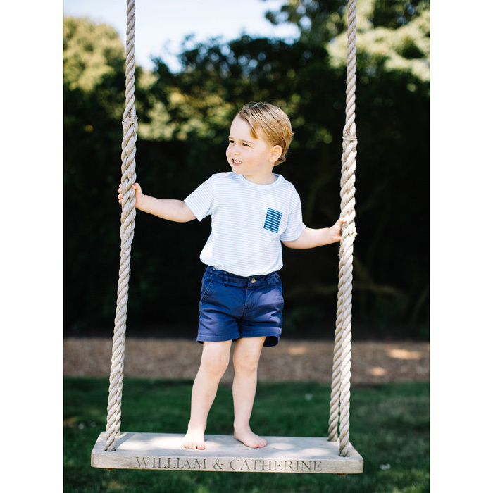 "July 2016: Princess Charlotte's big brother looked adorable and all grown-up wearing a striped shirt, while standing barefoot on a large wooden swing that featured his parents names: ""William & Catherine."" 