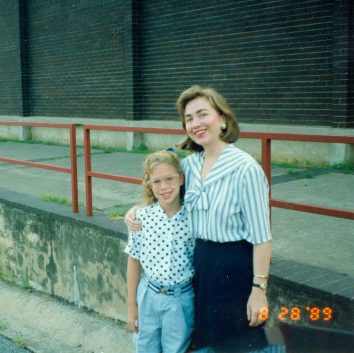 "'80s fashion was alive and well in a tender moment captured between Hillary and her daughter on the first day of school. Chelsea noted of the picture, ""My mom is rocking that '80s collar!""