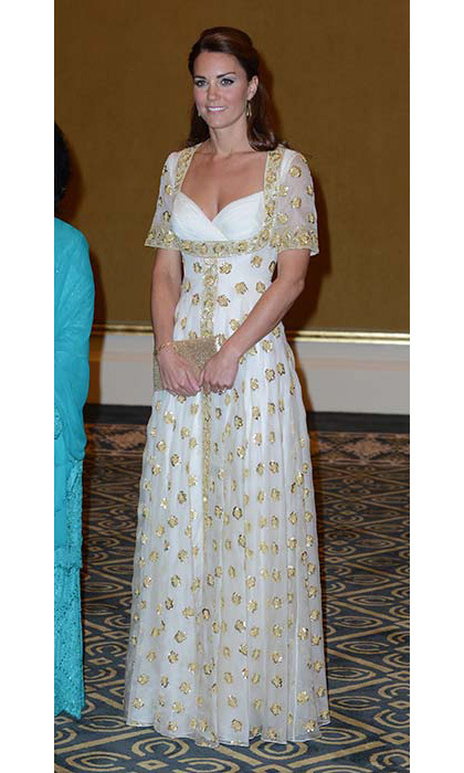 The mother of two pulled out all the stops for a state dinner in Malaysia, donning a custom Alexander McQueen dress by Sarah Burton. The gold embroidery was made using hibiscus, Malaysia's national flower.
