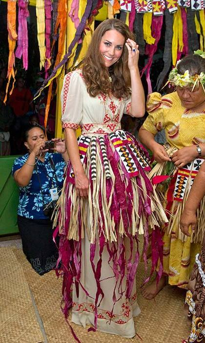 The Duchess strayed from her traditional tailored style with a boho-inspired Alice Temperely dress. She let her hair down in 2012 visiting Tuvalu, where she danced in a straw skirt and flower crown.