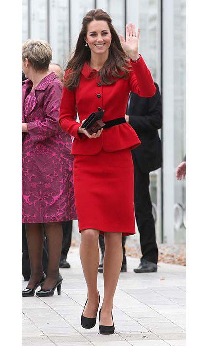 The Duchess of Cambridge looked resplendent in a red skirt suit by Louise Spagnoli for a trip to Christchurch's Botanical Gardens.