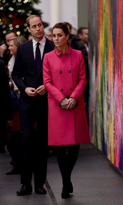 Prince William's wife was pretty in pink donning a Mulberry coat and Jimmy Choo pumps for her tour of One World Trade Center in New York City. 