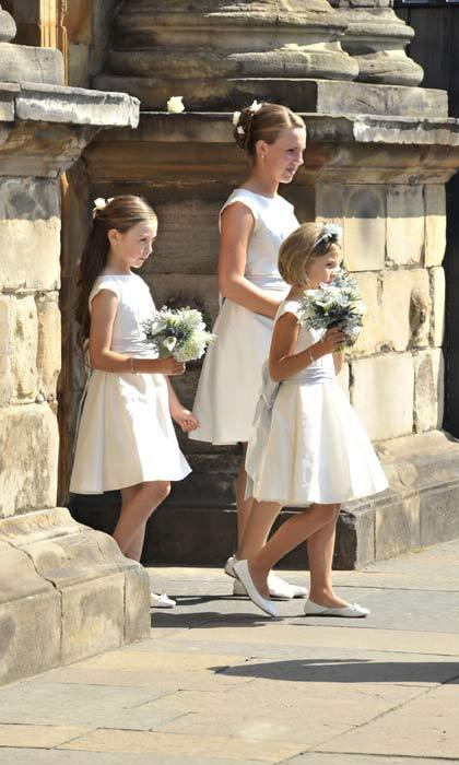 The bride was accompanied by her maid of honor, horse trainer Dolly Maude, whose six-year-old son Ted, Miss Phillips' godson, acted as page boy.