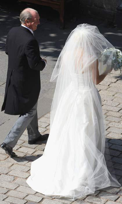 Arriving at the church, Zara Philips looked calm and collected as she and father Captain Mark Philips entered Canongate Kirk. 