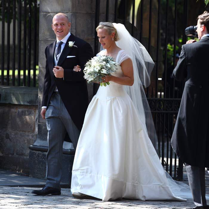 Here comes the bride! Mike couldn't wipe the smile from his face as he emerged from the church with his new wife.