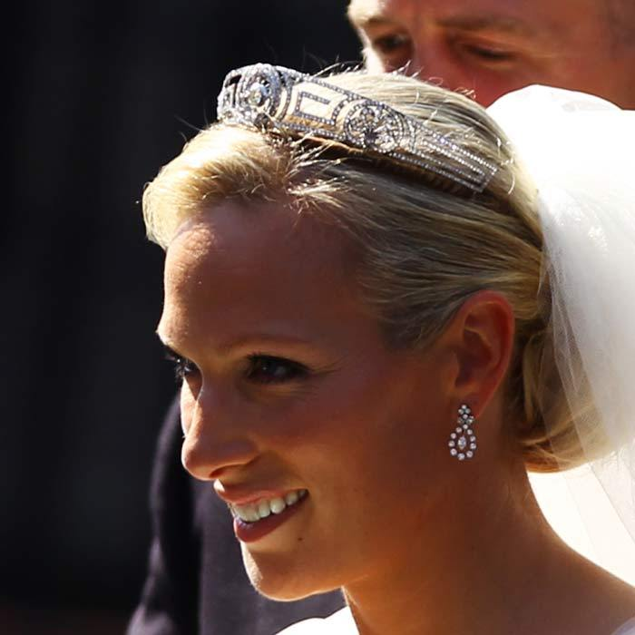 Something borrowed. Zara's chic chignon was carefully held in place by the Greek 'Key' tiara, lent to Zara by her mother, Princess Anne. It was once owned by Princess Alice, the mother of Prince Philip.