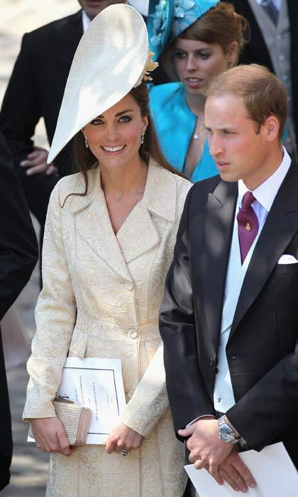 Not wanting to steal the limelight from the bride, Kate wore an understated but beautiful embroidered nude-hued dress coat and matching pumps.