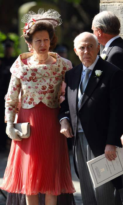 The mother-of-the-bride, Princess Anne, looked beautiful in a peach dress, cream and pink embroided jacket and an elaborate lace and flower detail fascinator.