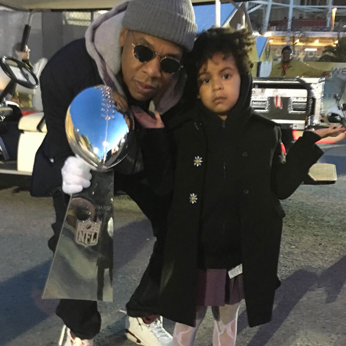 Blue Ivy looked #unimpressed posing with her cool dad <b>Jay Z</b> and the Super Bowl 50 trophy.