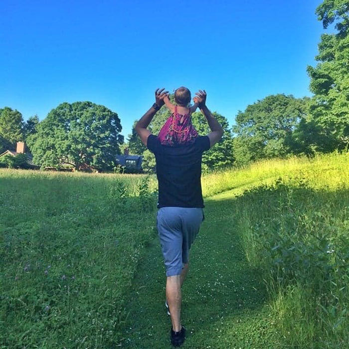 <b>Tom Brady</b> toted his little girl Vivian on his shoulders through a scenic field.