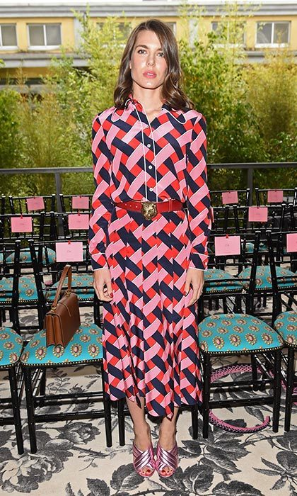 Turning heads in a geometric print Gucci shirt dress.