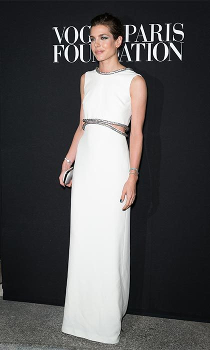 Showing a hint of midriff in this white Gucci cut-out gown.