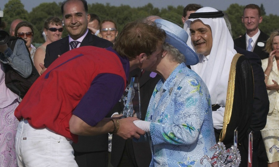 The monarch's hands in his, Prince William planted a kiss on his grandmother after playing in the polo match at the Royal Ascot in England. 
