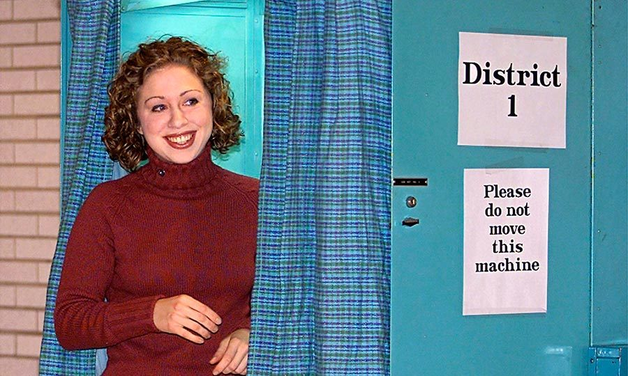 Chelsea couldn't contain her excitement as she exited the voting booth after casting her vote for her mother in the Senate race. The Clintons voted together at the Douglas Grafflin Elementary School in Chappaqua, New York, in 2001.