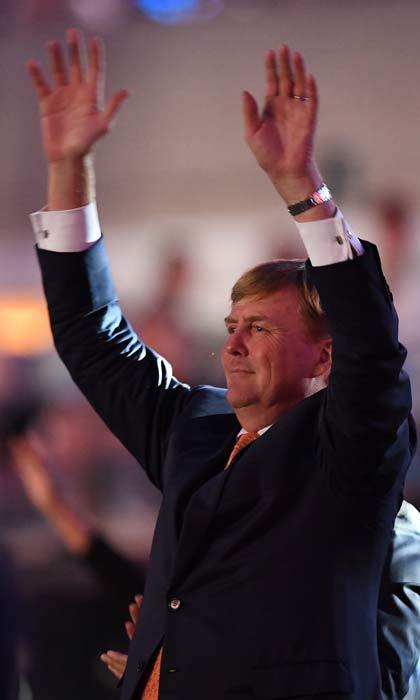 Put your hands in the air like you just don't care! King Willem-Alexander of the Netherlands looked like he was having a great time as he joined in on a Mexican wave during the Rio Olympics opening ceremony.