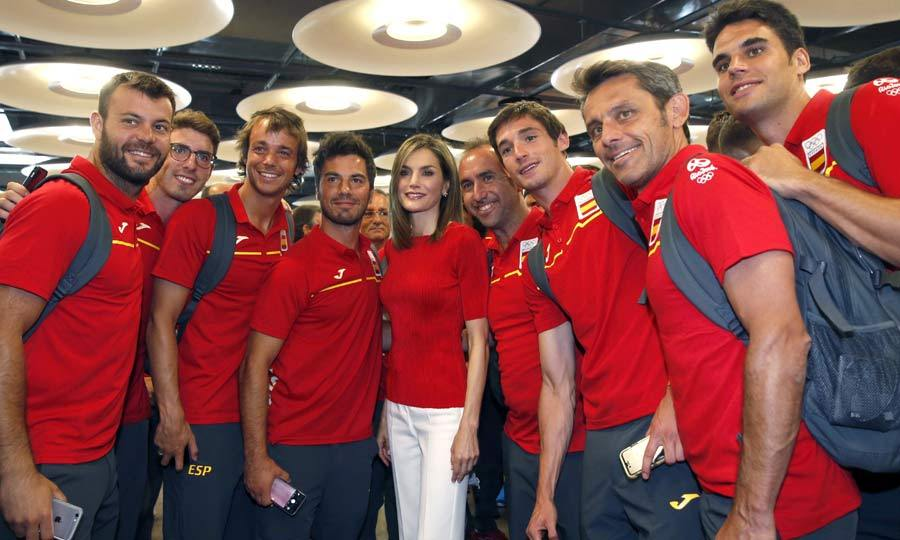 Queen Letizia posed with members of the Spanish Olympic team, as she and King Felipe bid the athletes good luck at the airport in Madrid.