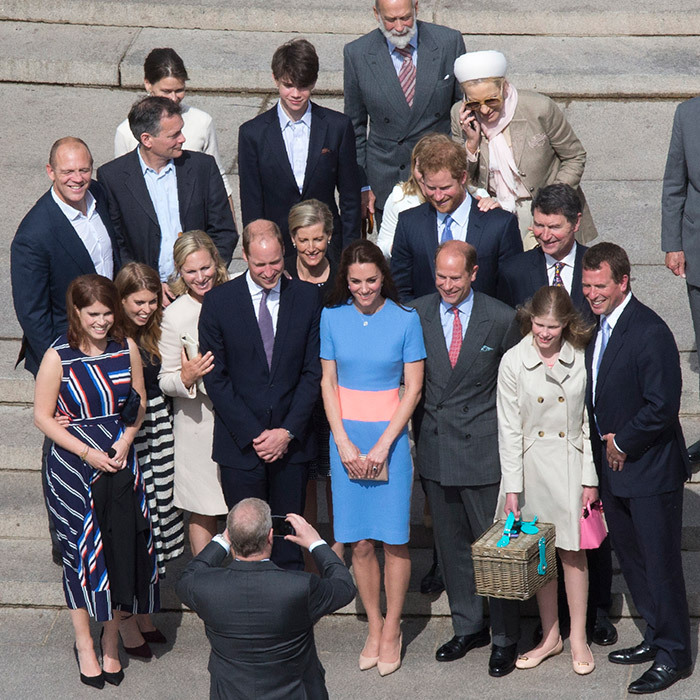 June 2016: Beatrice and Eugenie, bottom left, join in for a very special Royal Family photo taken by dad Prince Andrew during the special street party outside Buckingham Palace in honor of Queen Elizabeth II's official 90th birthday. 
