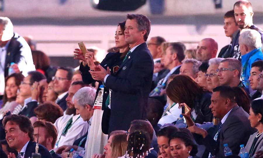 Proud royals Crown Prince Frederik and Crown Princess Mary were the first on their feet as Denmark's delegation entered the Olympic arena during the Opening Ceremony.