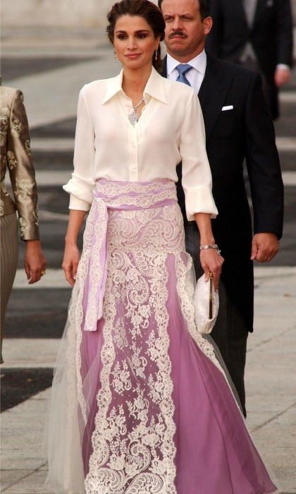 May 2004: Queen Rania showed her increasingly fashion forward style with this look – a silk blouse and lace skirt – at Spanish Crown Prince Felipe and Queen Letizia's wedding in Madrid. 