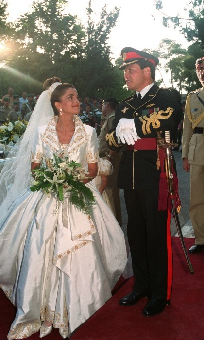 June 1993: With the help of designer Bruce Oldfield, Rania reigned on her wedding day. The gown featured short sleeves and regal gold embellishment.