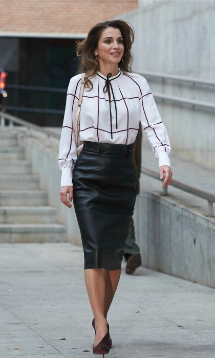 November 2015: Rania worked her street style in a leather skirt while walking through Madrid. 