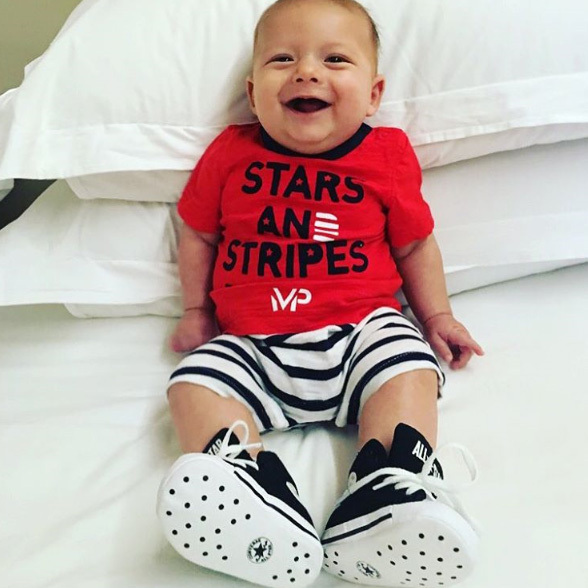 Ever the enthusiastic supporter, Boomer is one happy little baby.