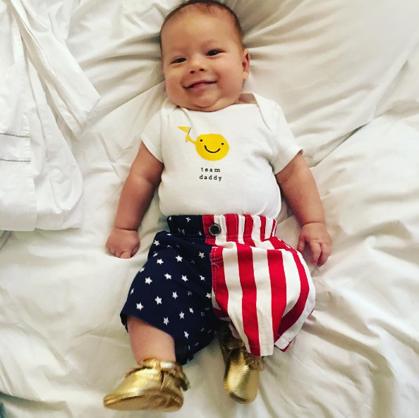 Michael Phelps and Nicole Johnson's baby boy Boomer is his daddy's number one fan! The three-month-old accompanied his parents to Rio to cheer on Michael, the most decorated Olympian of all time. Boomer has been proudly sporting his stars and stripes for Team USA.