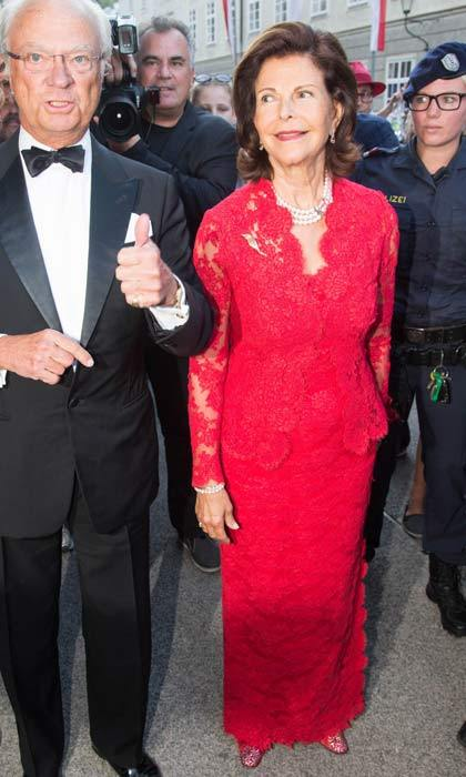 "Queen Silvia looked glamorous in a red floor-length dress as she arrived at the ""Manon Lescaut"" opera in Salzburg.