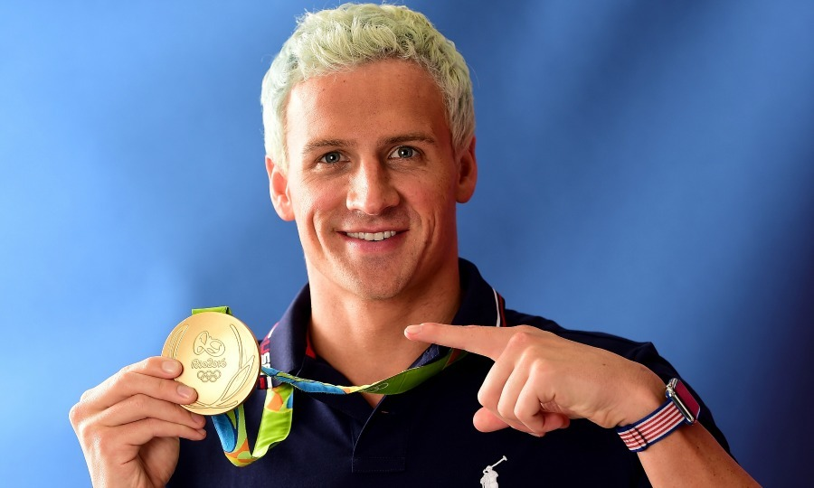 <b>Ryan Lochte and three other Team USA swimmers robbed at gunpoint</b>