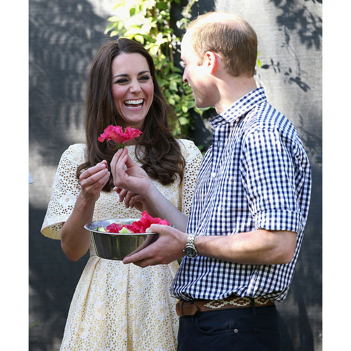 A flower for his funny lady! Kate laughed as her husband presented her with a flower at the Taronga Zoo in Sydney, Australia. 
