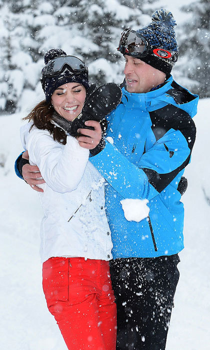 Snow fights and fun! Kate laughed as her husband played with her in the snow during a ski holiday in France with their children.