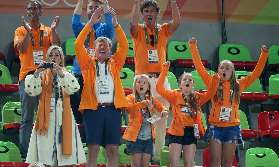 Queen Maxima, King Williem-Alexander and their squad, including their daughters, Princess Catharina-Amalia, Princess Alexia and Princess Ariane got on their feet and cheered for the Netherland's  Sanne Wevers, who took home the first-ever gold medal in Women's Gymnastics during the balance beam competition. 