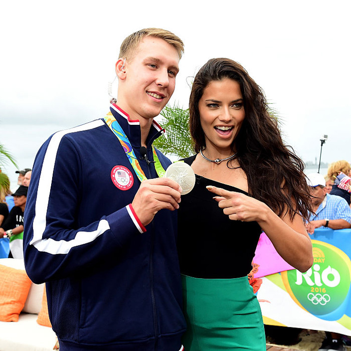 "Check out his bling! <a href=""https://us.hellomagazine.com/tags/1/Adriana-Lima/""><strong>Adriana Lima</strong></a> posed with USA swimmer Chase Kalisz and his silver medal on the set of the <i>Today</i> show.