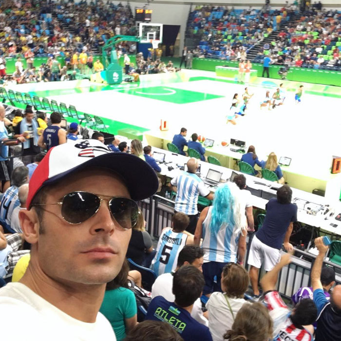 "Team USA ""all day!"" <a href=""https://us.hellomagazine.com/tags/1/zac-efron/""><strong>Zac Efron</strong></a> shared a courtside selfie as he cheered on American athletes in Rio.