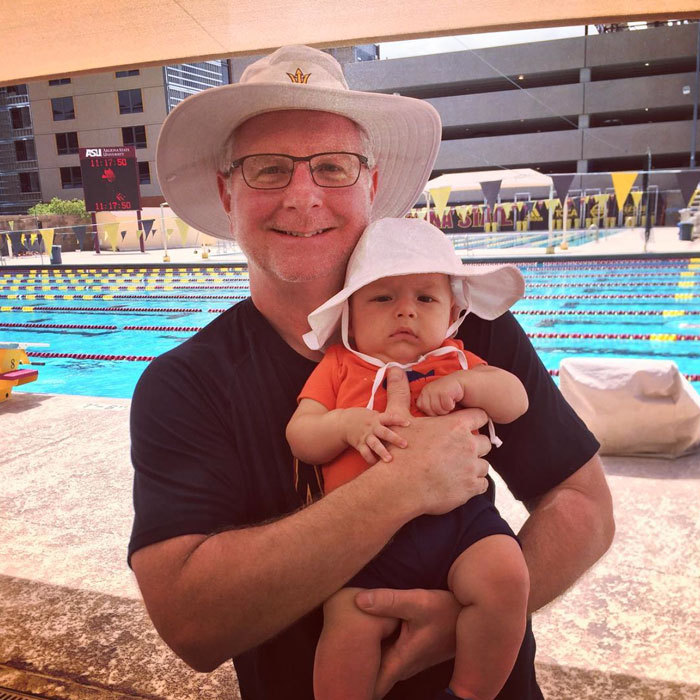 "With Michael Phelps officially in retirement, it's time for a new generation of Phelps swimmers! Boomer hit the pool with his dad's old swim coach, Coach Bowman. The little fish-in-the-making looked adorable in the poolside photo captioned, ""Got to come hang out at the pool with grandpa @coach_bowman !! We have our matching hats on to protect us from the sun.""