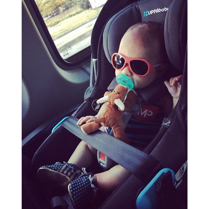 Boomer was riding in style around the streets of Rio during the 2016 Olympics. Michael Phelps' son looked extra cool decked out in patriotic colors and summer shades.
