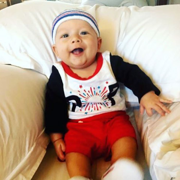 "Go team USA! Boomer was cheer-ready in his American-colored ensemble and matching headband. The caption attached to the spirit-filled photo read: ""Mom these head bands are sweet!!! #headbandgamestrong.""