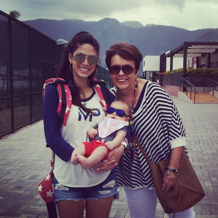 Boomer was snug as a bug wedged between two of his favorite ladies, mom Nicole Johnson and grandma Phelps in Rio.