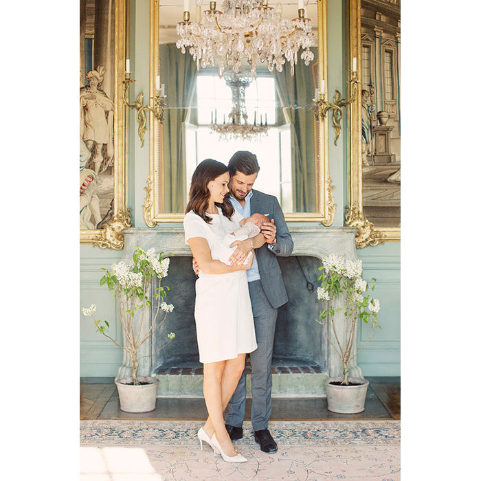 Doting parents! Sofia cradled Alexander as Carl caressed his son's head in a loving family photo.