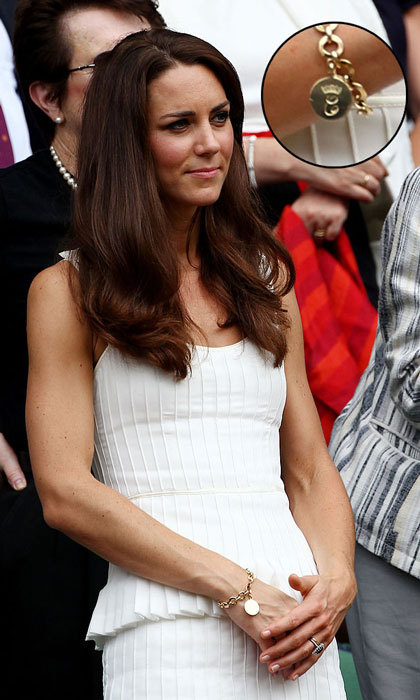 "C is for Catherine! The <a href=""https://us.hellomagazine.com/tags/1/kate-middleton/""><strong>Duchess of Cambridge</strong></a> accessorized her white summer frock at Wimbledon with a monogrammed charm bracelet. The jewelry piece, which is engraved with a C topped with a crown, was gifted to Kate by her mother-in-law Camilla, the Duchess of Cornwall. 