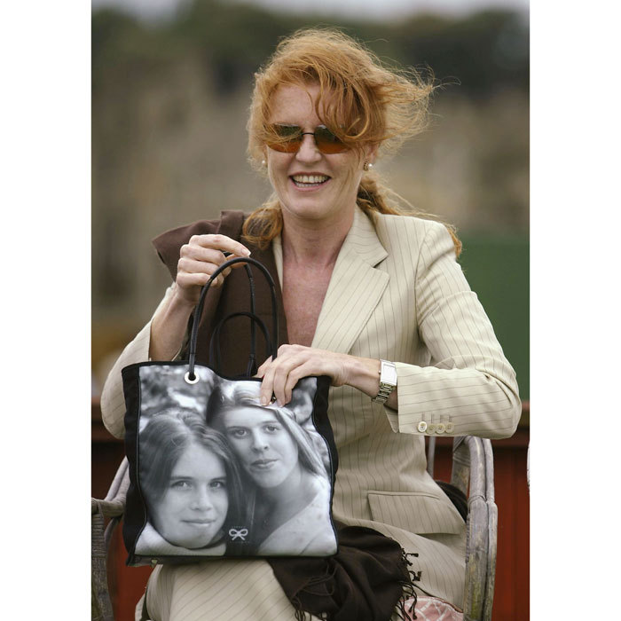 "While some people wear their heart on their sleeve, others wear it on their bag. <a href=""https://us.hellomagazine.com/tags/1/Sarah-ferguson/""><strong>Sarah Ferguson</strong></a> toted a purse featuring the faces of her daughters Princesses <a href=""https://us.hellomagazine.com/tags/1/princess-beatrice/""><strong>Beatrice</strong></a> and <a href=""https://us.hellomagazine.com/tags/1/princess-eugenie/""><strong>Eugenie</strong></a> during a polo match in 2003.