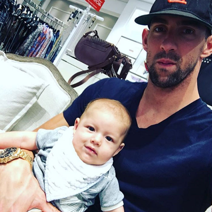 The adorable father-son duo kept each other company at a store, while mom Nicole was shopping.