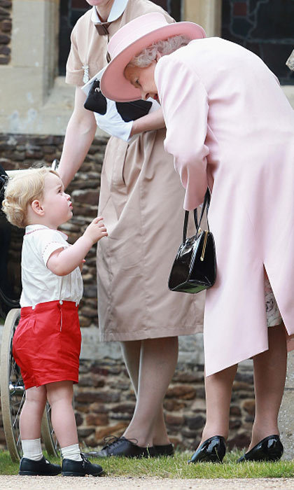 George had a quick word with great-grandma, Queen Elizabeth, before he was taken into the baptism ceremony.