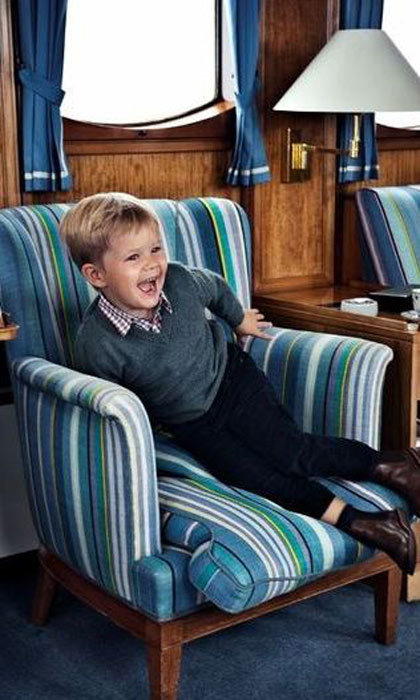 A dapper Prince Vincent couldn't sit still during his fourth birthday photo shoot. 