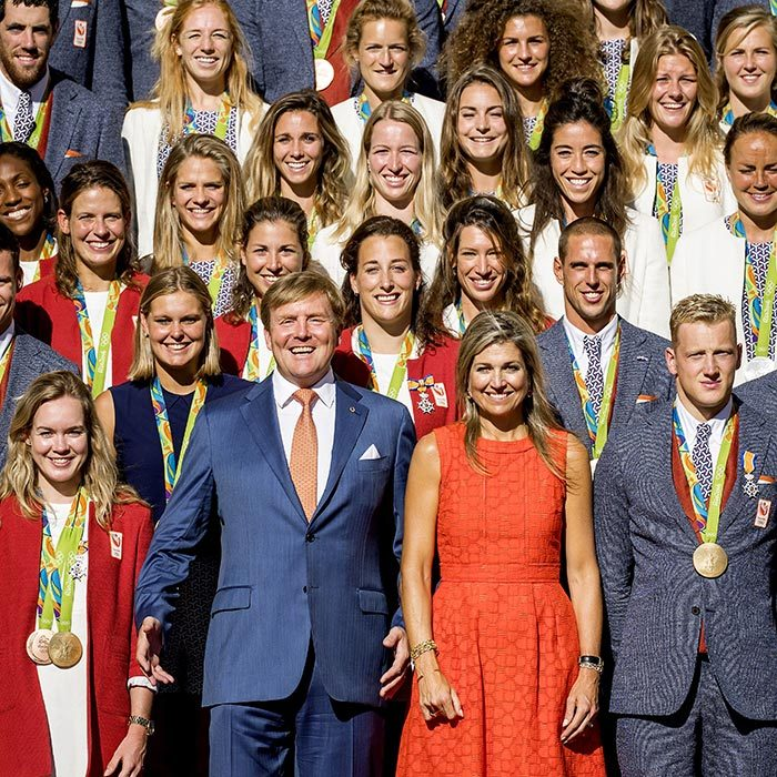 Say cheese! King Willem-Alexander and Queen Maxima of the Netherlands sported huge grins as they joined their country's equally content Olympic medal winners at the Palace Noordeinde on August 24, 2016 in The Hague.