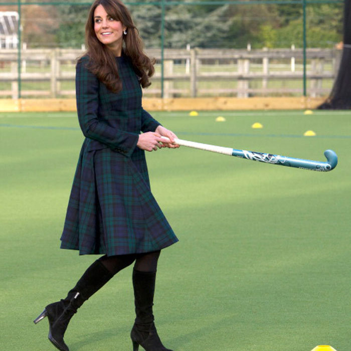 This time, the Duchess opts for a flowy plaid coat while visiting St. Andrew's School.
