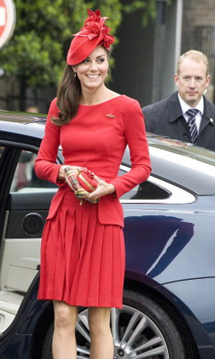 Kate makes a bold choice with this scarlet red Alexander McQueen outfit for the Queen's Diamond Jubilee celebration in 2012. 