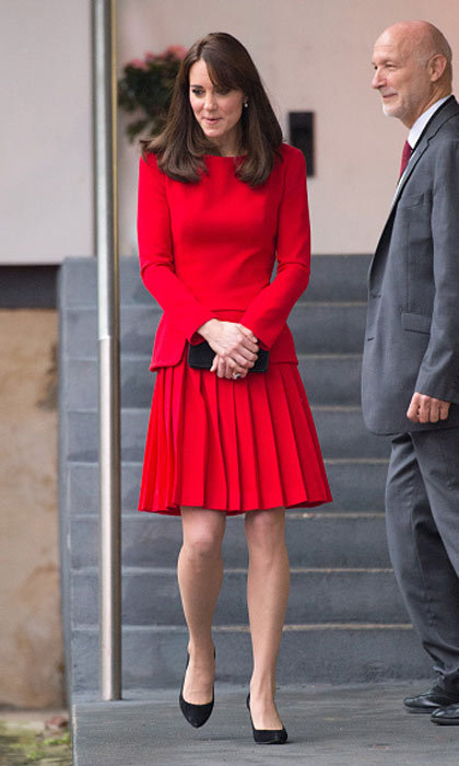 In one of her latest Alexander McQueen looks, Kate wears scarlet red - a welcome change from her more muted pieces.