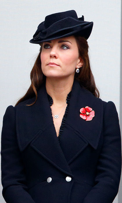 Kate has proved herself to be a queen in her own right, at least in the fashion world. The Duchess wears a navy coat and matching cocktail hat here.